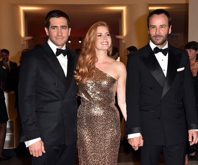 Amy poses with co-star Jake Gyllenhaal and director Tom Ford.