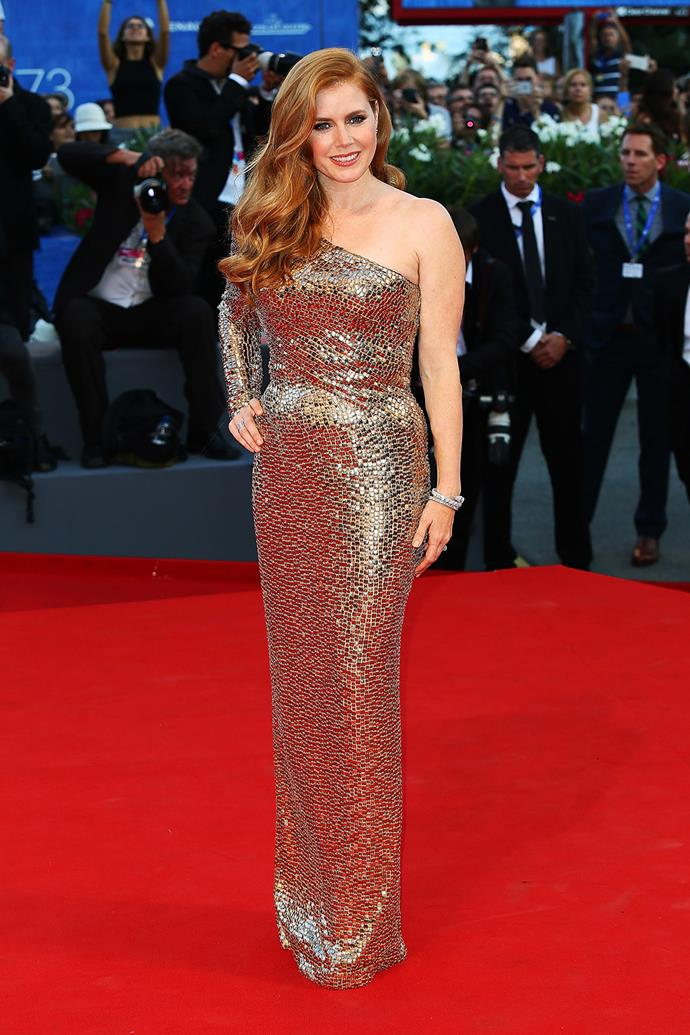 Amy Adams showed off her own take on the metallic gown trend with this shimmering golden one-sleeved number.