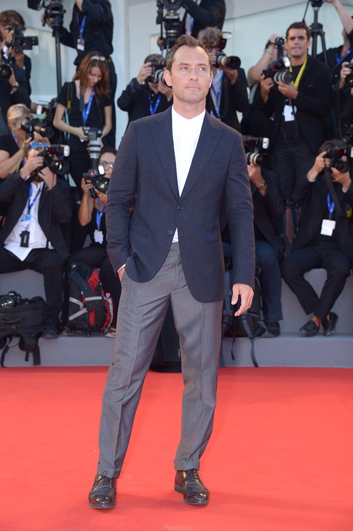 Jude Law opted for a navy suit for the premiere of *The Young Pope*.
