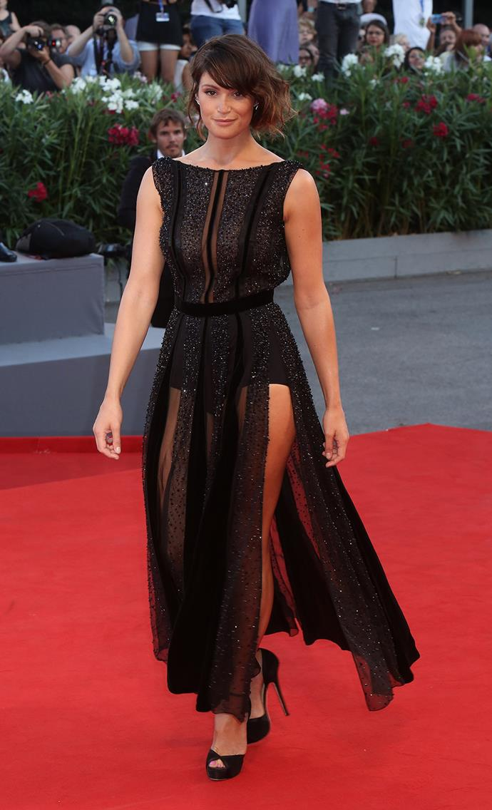 The English star and former Bond Girl showed off her trim figure in a sheer black gown.