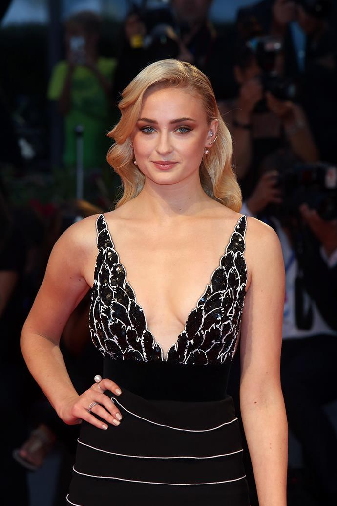 Sophie stunned on the red carpet in a form-fitting black and white gown.
