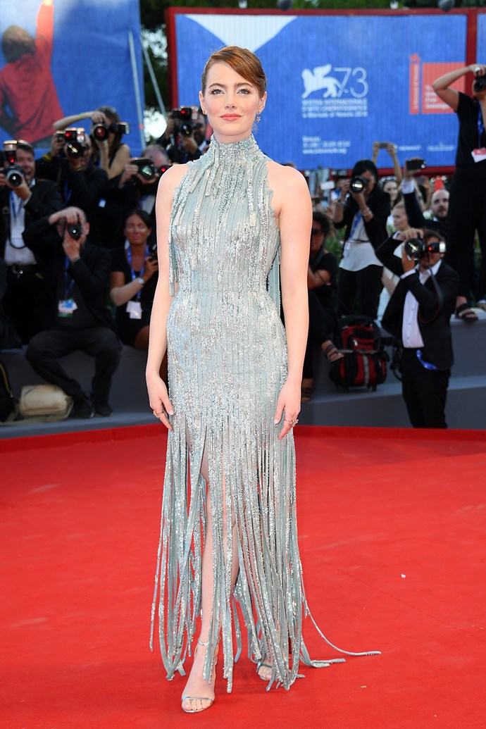 On opening night, Emma Stone made a dramatic entrance in this silver fringed Versace gown.