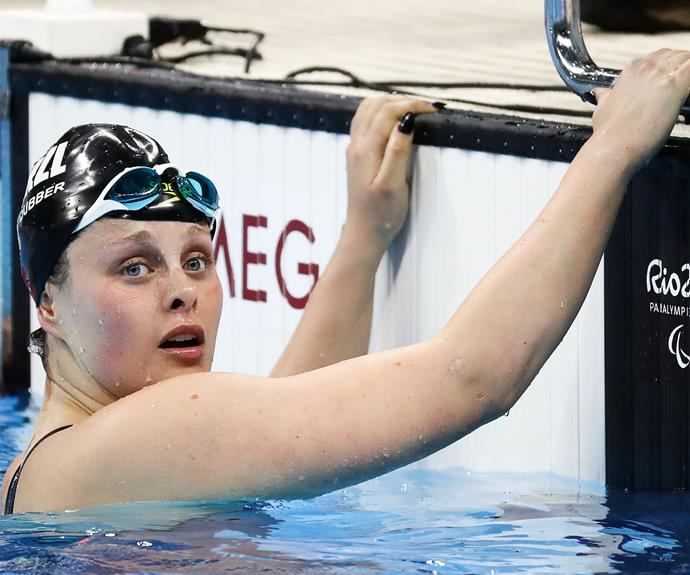 Rebecca is pictured in the pool after learning of her bronze medal win.