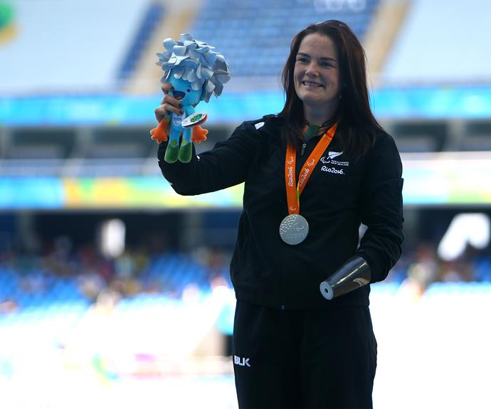 Team New Zealand flagbearer Holly Robinson clinched the silver after a personal best effort int he women's javelin F46 final - moving New Zealand closer to their target of 18 medals for this Paralympic Games.