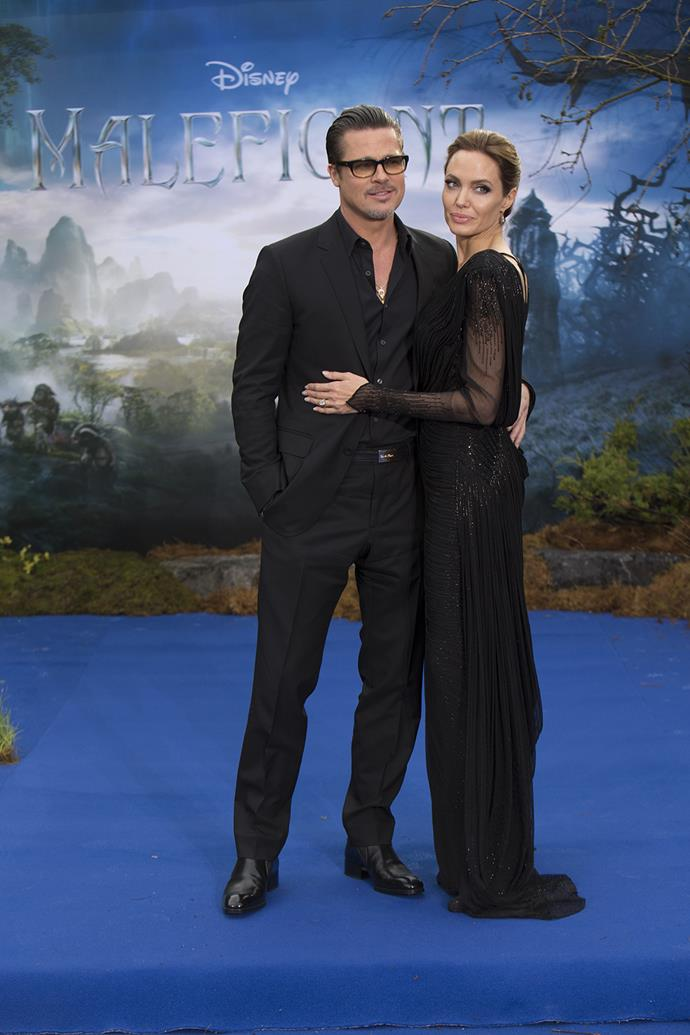 Brad supports Angelina at the premiere of her movie *Maleficent* in 2014.