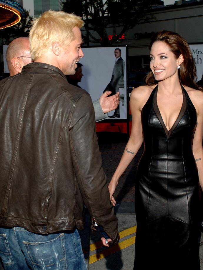 """The couple share a smile at the 2005 premiere of *Mr and Mrs Smith* in Los Angeles. In a later interview, Angelina said of the film: """"Not a lot of people get to see a movie where their parents fell in love""""."""