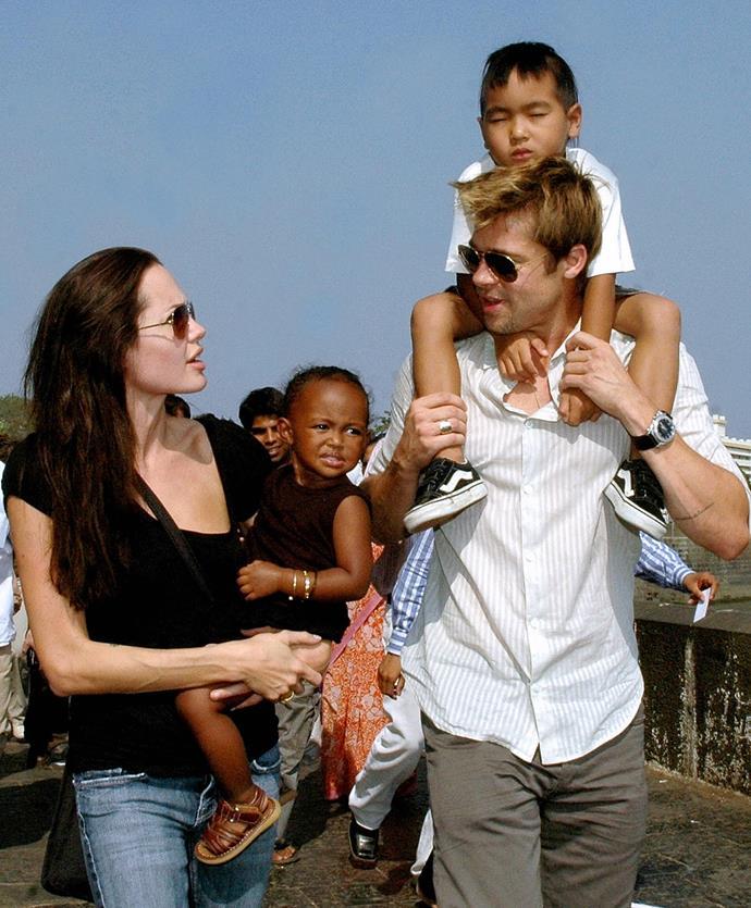 Angelina, holding Zahara, and Brad, holding Maddox, on a trip to Mumbai in 2006.