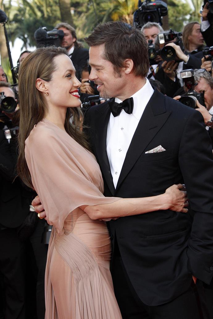 The couple share a sweet moment at the premiere for Brad's film *Inglourious Basterds* in 2009.