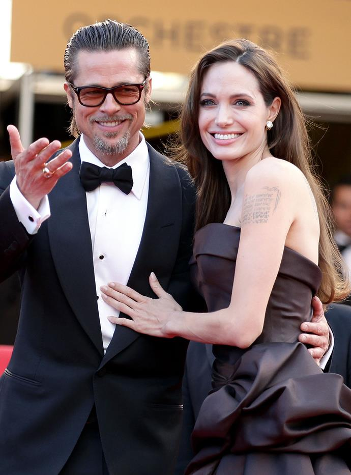 Angelina walks the red carpet in Cannes with Brad for the premiere of his movie *The Tree of Life* in 2011.