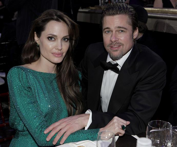 The couple pose for a photo during the 2011 Golden Globe Awards.