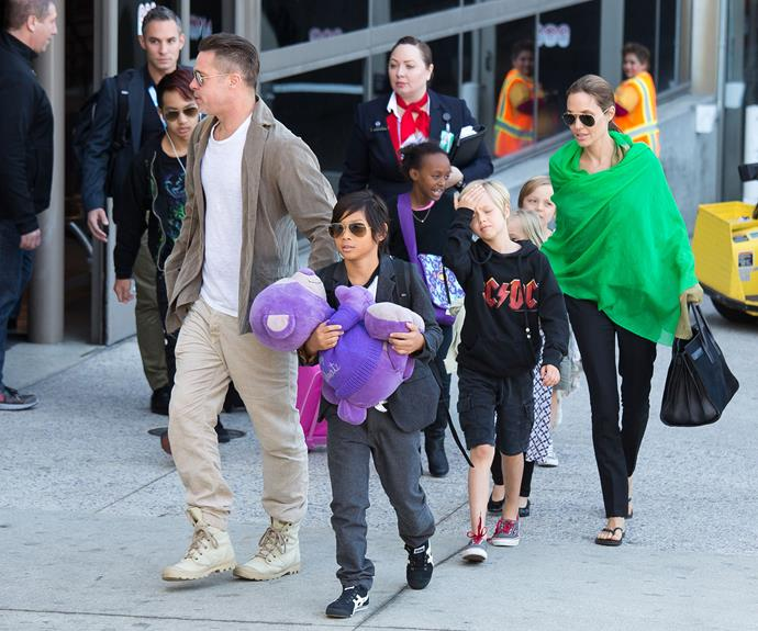 The Jolie-Pitt clan are spotted out in Los Angeles in 2014. The couple share six children together - Maddox, 15, Pax, 12, Zahara, 11, Shiloh, 10, and eight-year-old twins Knox and Vivienne.