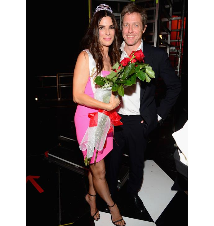 Hugh with his *Two Weeks Notice* co-star Sandra Bullock at the Spike TV Guys' Choice Awards in 2014, where he presented her with the award for the 'Decade of Hotness'. Photo: Getty