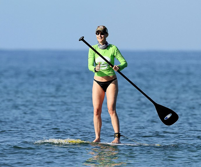Actress and director Helen Hunt makes the most of the waves in Maui, Hawaii,
