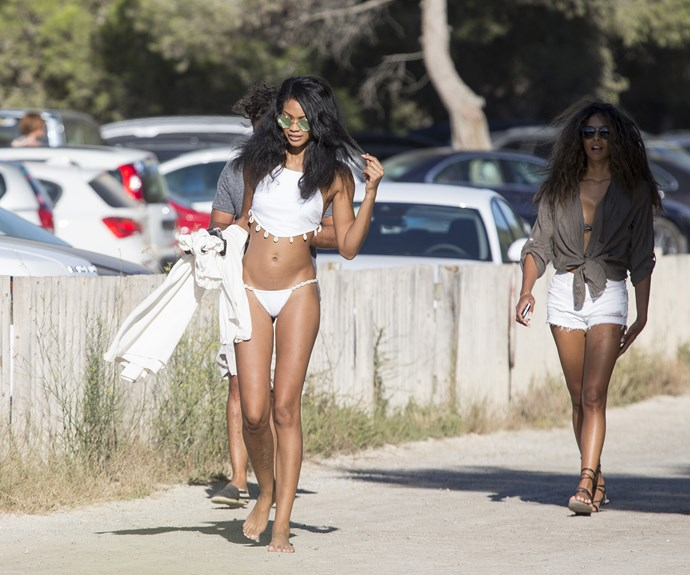 Model Chanel Iman takes a walk with friends in Ibiza.