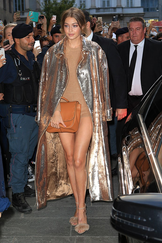 All that glitters is Gigi! The golden goddess was flaunting her enviable pins at Milan Fashion Week.