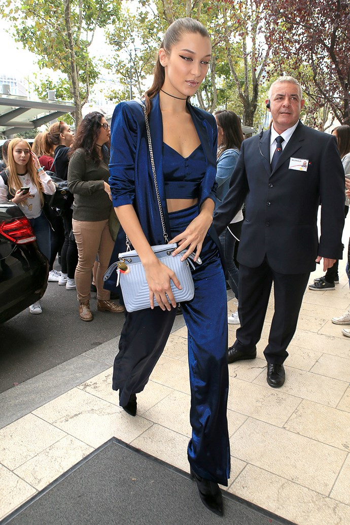 Bella Hadid flaunted her abs in a crop top, wearing a silky navy three-piece-suit in Milan, Italy.