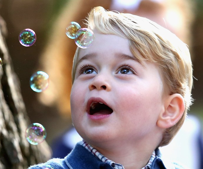 Little George marvels at the magical bubbles