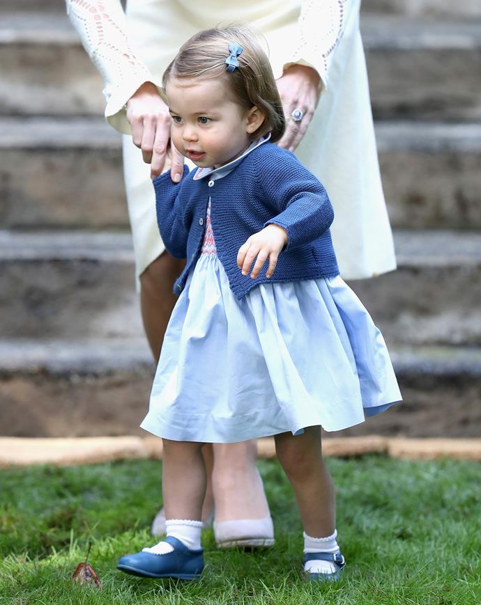 Princess Charlotte looking cute as a button in her little pinafore and knitted cardigan