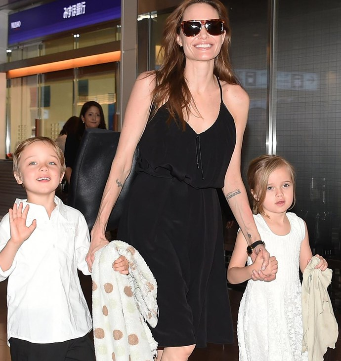 Angelina Jolie with the twins Knox (left) and Vivienne (right).