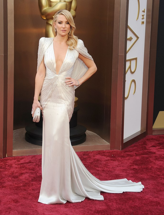 In one of her most iconic looks ever, Kate arrived at the 86th Annual Academy Awards in 2014 wearing this jaw-dropping white gown