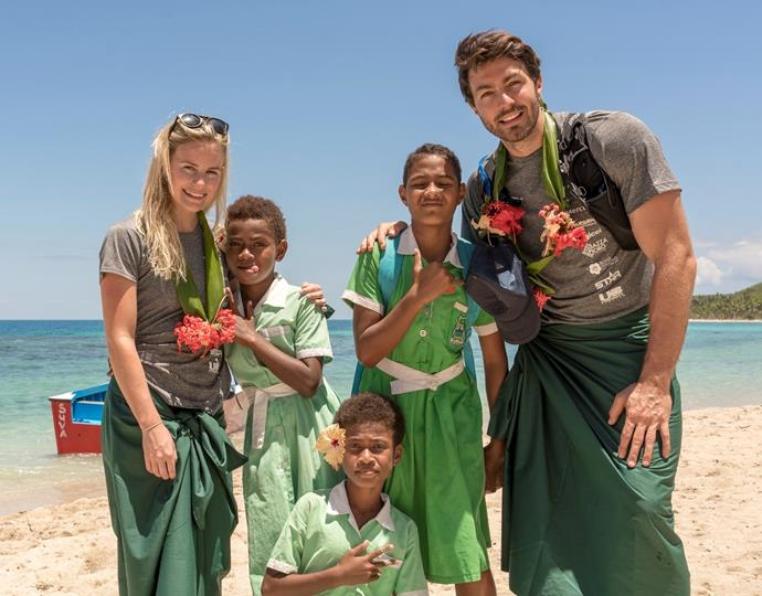 Matilda Rice and Art Green pose with children of Fiji's Kese Village.
