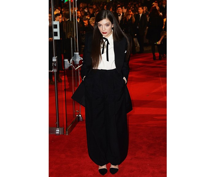 **November 10, 2014** Lorde attended the World Premiere of *The Hunger Games: Mockingjay Part 1* in London wearing our favourite take on a tuxedo to date. Her song 'Yellow Flicker Beat' was the lead single for the film's soundtrack and earned her a Golden Globe nomination.