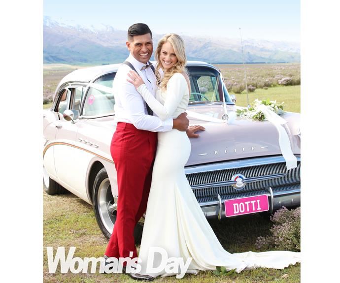 The couple are all smiles as they pose beside the fab '50s Buick Larissa arrived in.