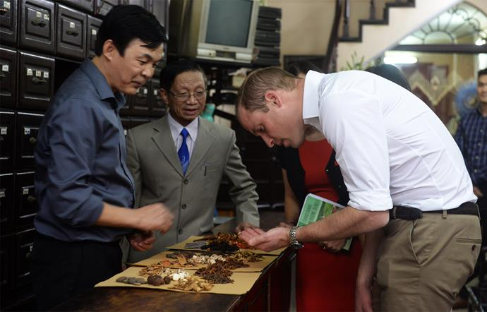 The Prince examines some traditional medicine in Hanoi's Old Town. Photo: Getty