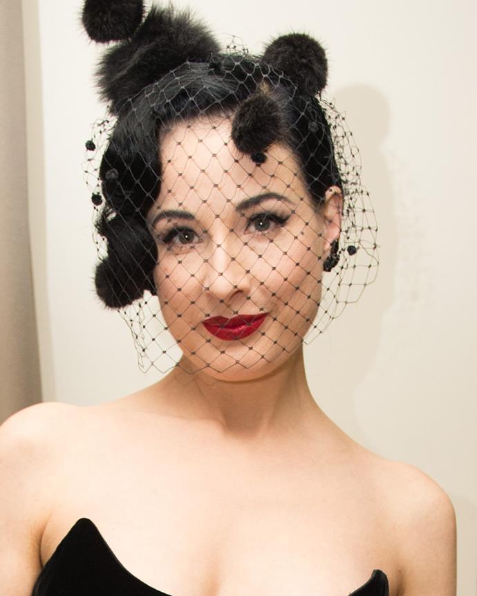 8 American burlesque dancer, model, costume designer, Dita von Tesse.