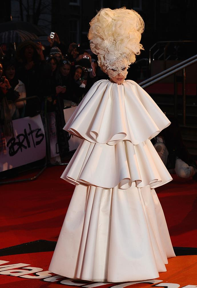 2010 saw Gaga arrive at the Brit Awards in this unusual, three-tiered ensemble, Marie Antoniette hair and masquerade mask