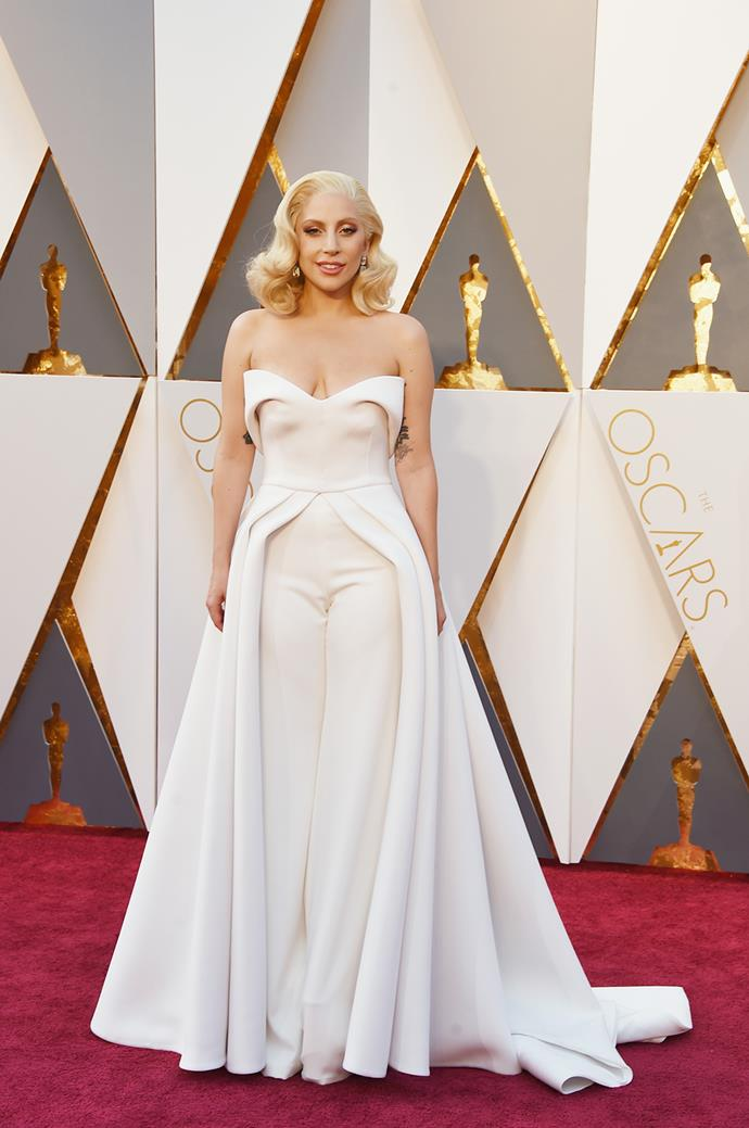 At the 2016 Academy Awards, Lady Gaga was back to her tailored, chic wardrobe and stunned on the red carpet in this cream pantsuit.