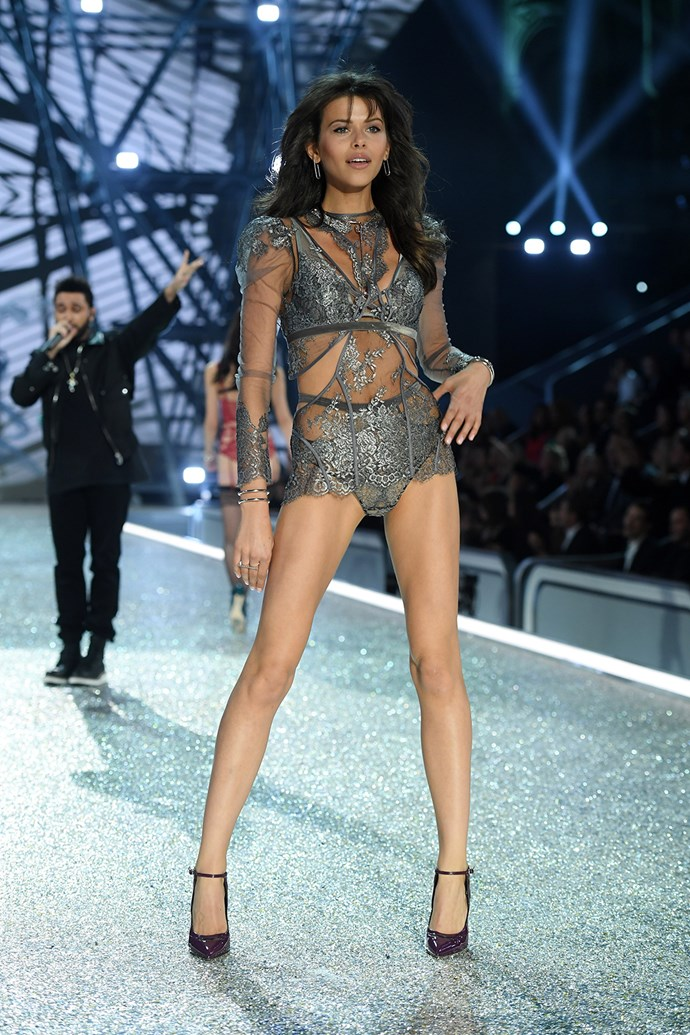 The New Zealander struck a pose as The Weeknd performed behind her.