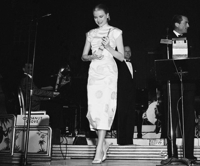 Grace Kelly accepting the statuette for World's Film Favourite Actor (Female) in 1956 at what was then known as the Foreign Press Awards. Gregory Peck presented her with the award. Photo: Getty