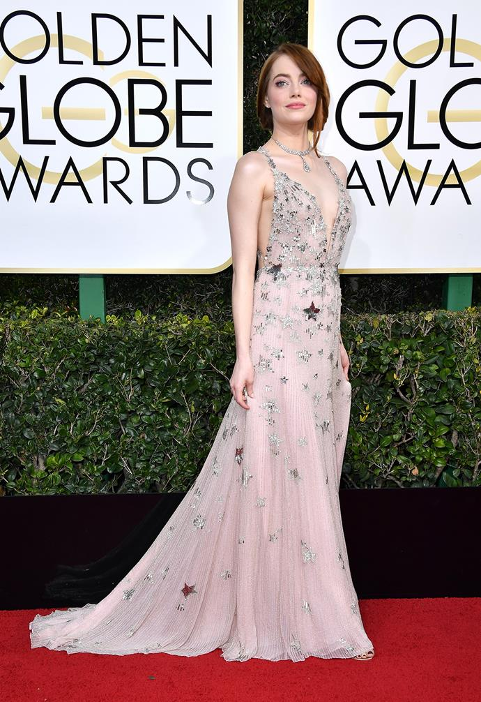 Emma Stone in star-studded Valentino before picking up an award for her role in *La La Land* in 2017.