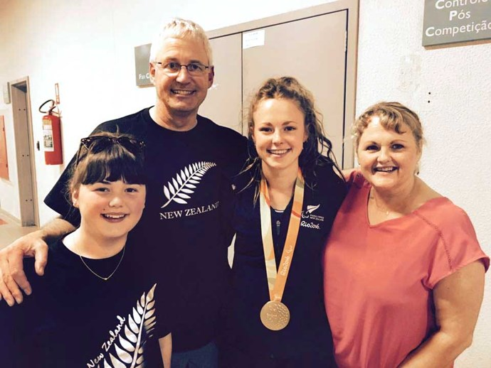 Sporting her gold medal alongside proud parents Tony and Di and sister Abby.