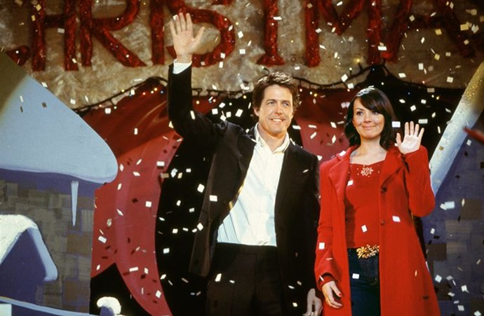 Hugh Grant and Martine McCutcheon in character as lovestruck David and Natalie.