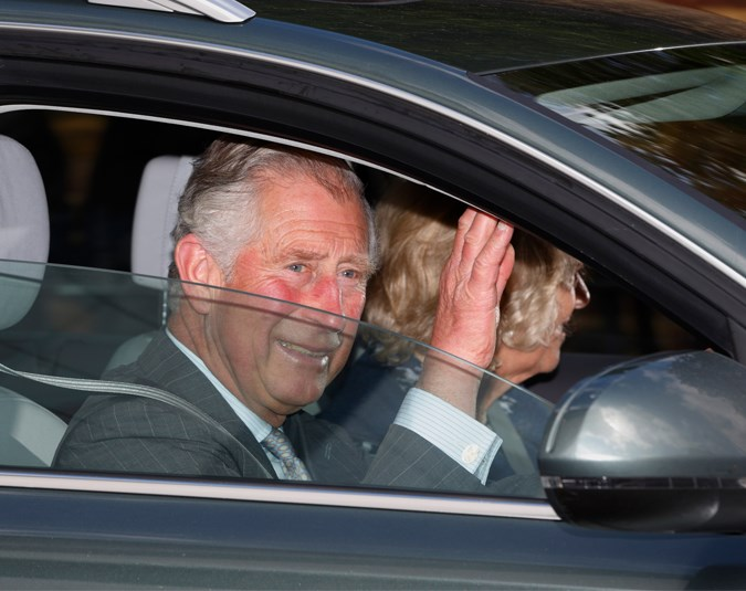 Charles and Camilla are seen driving into Kensington Palace to meet their new granddaughter.