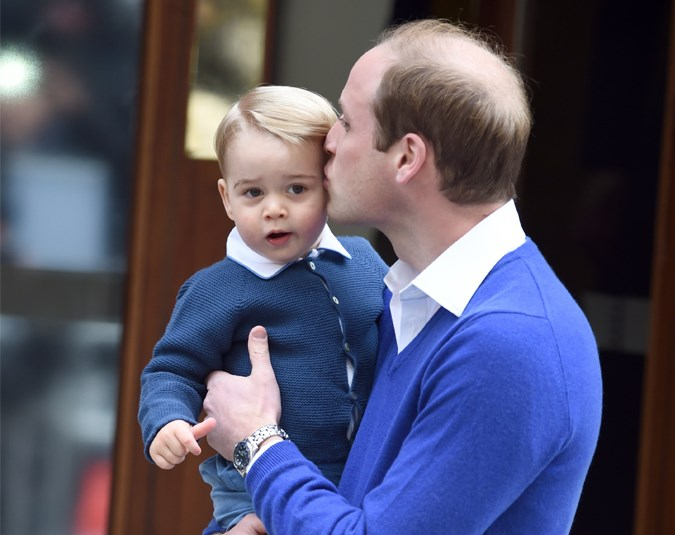 Wills gives his son Prince George a kiss before they go into the hospital.