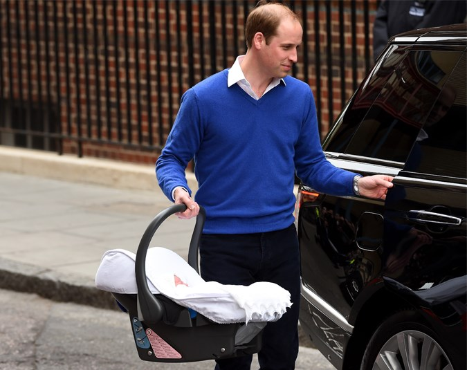 Wills puts the Princess in the car for the trip back to Kensington Palace.