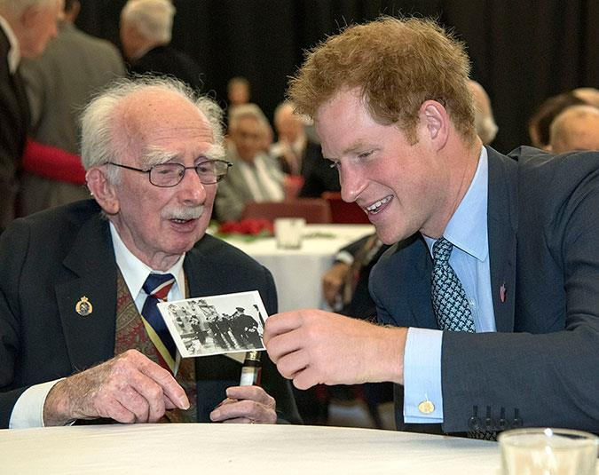 Prince Harry chats with Kenneth Newton, a 95-year-old WWII veteran.