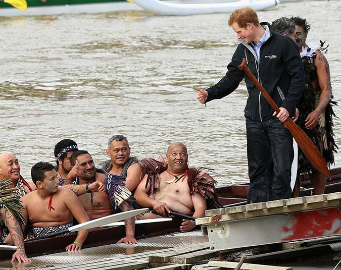 Prince Harry helps paddle a traditional Maori waka in Whanganui.