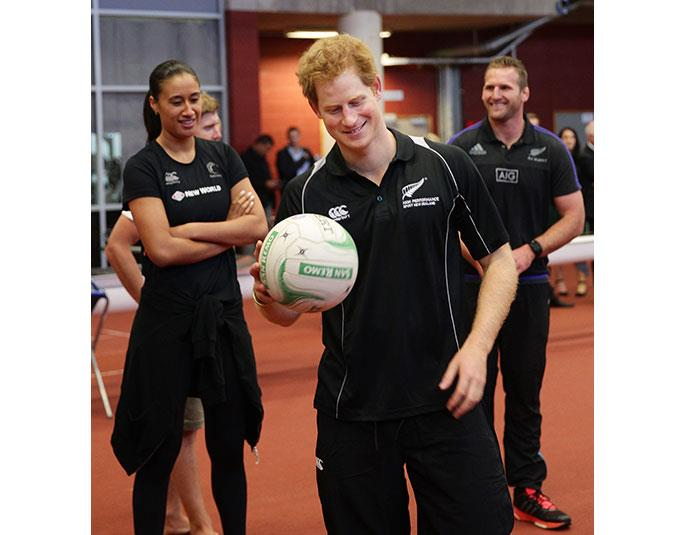 Maria Tutaia and Kieran Read look on as Prince Harry visits the AUT Millenium Institute of Sport.