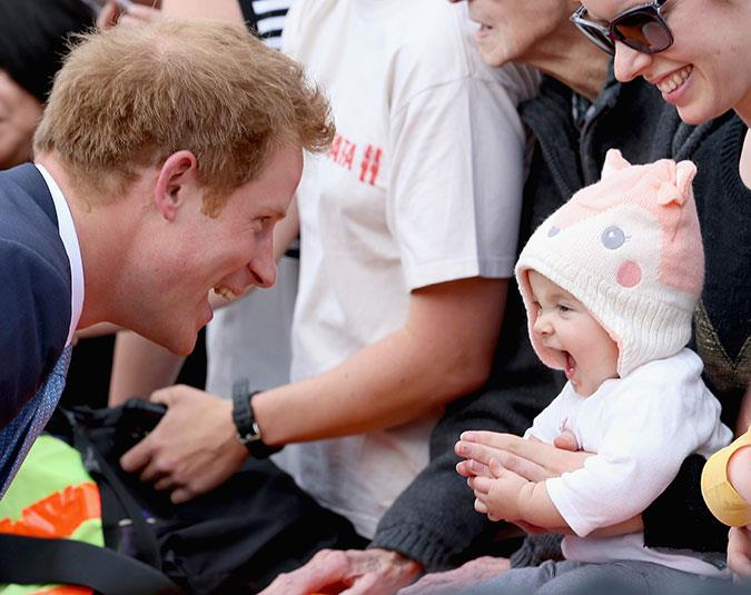 Prince Harry charms a gorgeous baby in Christchurch.