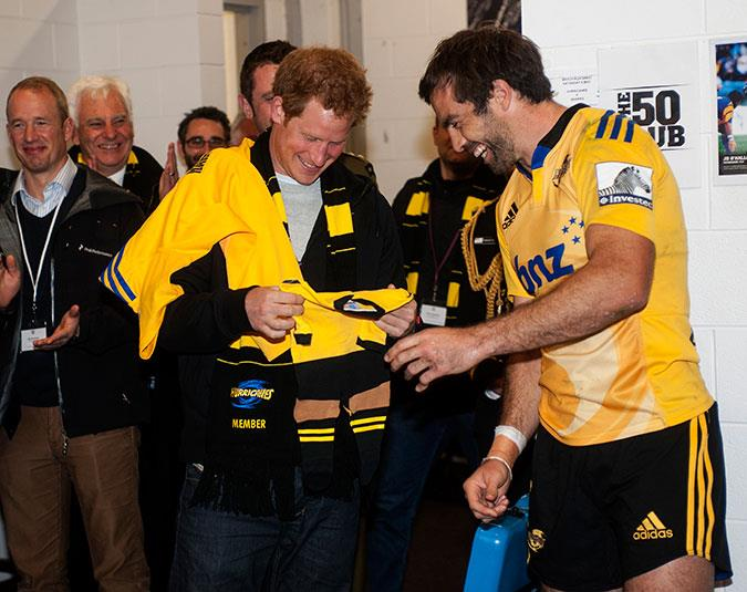 Prince Harry is gifted a onesie for newborn niece Princess Charlotte from Hurricanes captain Conrad Smith.