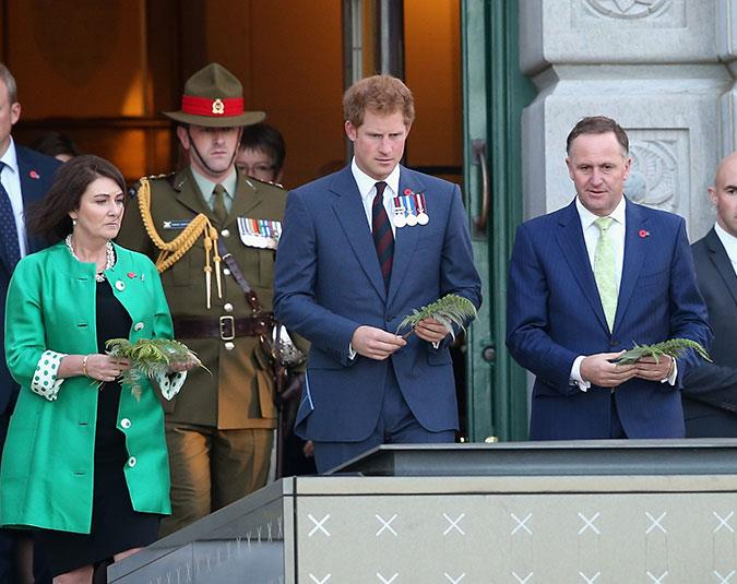 Prince Harry visits the Tomb of the Unknown Warrior at the Pukeahu National War Memorial Park in Wellington with John Key and wife Bronagh.