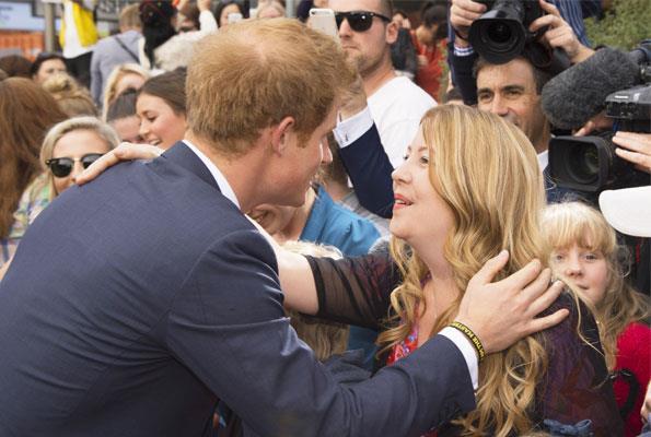 Harry had a kiss and a hug for Cantabrian Vicki McBratney, his former boarding school matron.