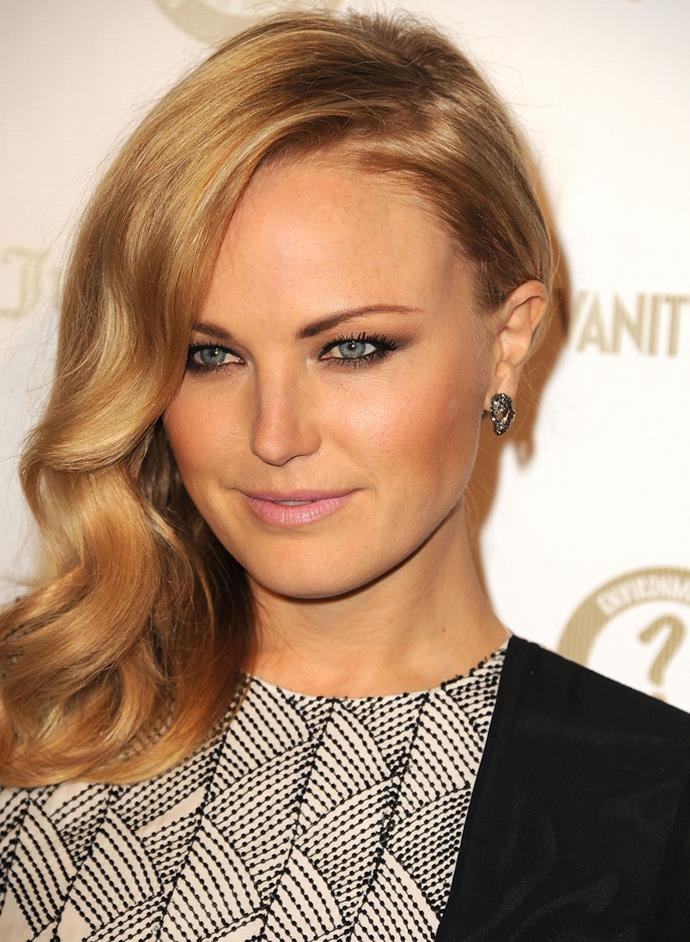 Actress Malin Akerman gives a cat-flick to her eyeliner, with her luscious waves softening the overall look
