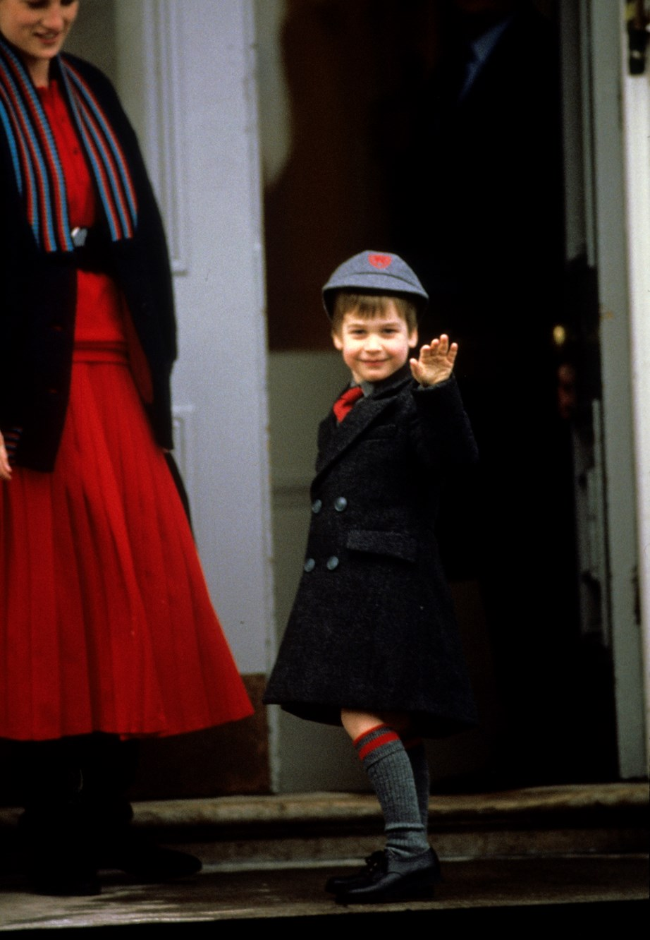 Prince William waves to the cameras on his first day at Wetherby School in January 1987. <br><br> *(Image: Getty)*