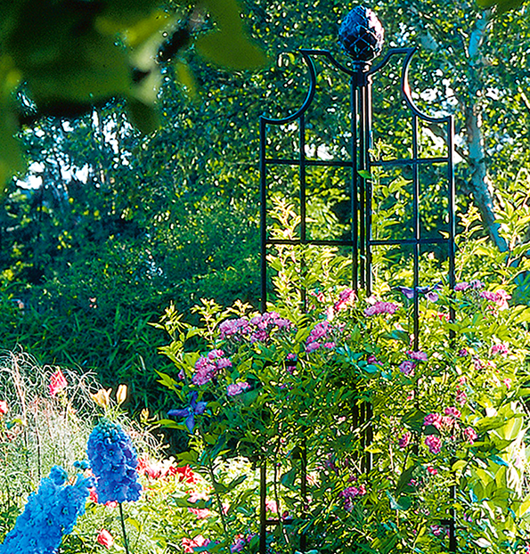 "An obelisk or ""tuteur"" is a speedy way to add height to a garden."