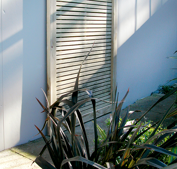 Slatted timber screens like this are available pre-made, so they're perfect for a quick fix.